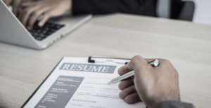 thumbnail picture of a meeting reviewing resume