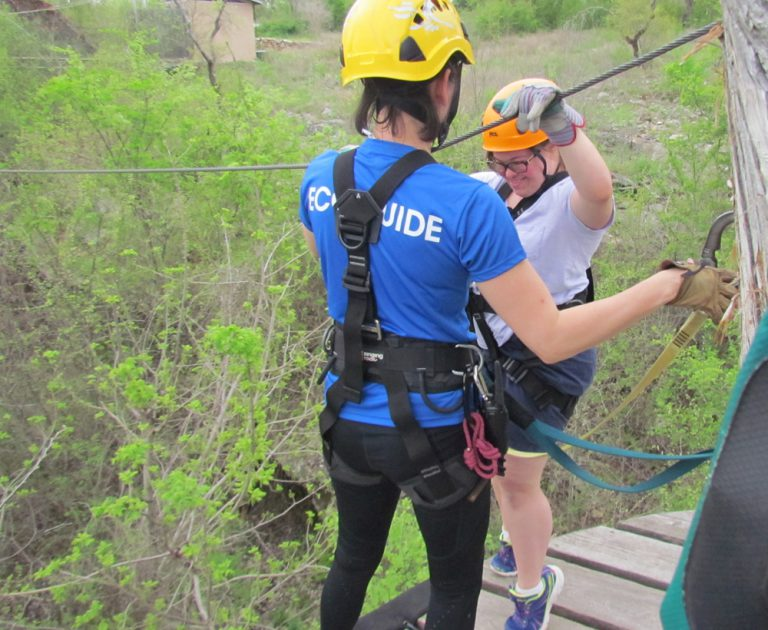 Participant and guide ziplining