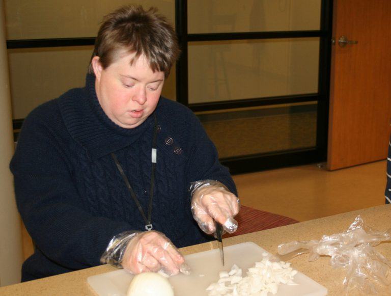 Participant chopping onions